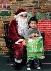 TSTC ToysTotsDelivery 3 214x300 - TSTC spreads holiday cheer