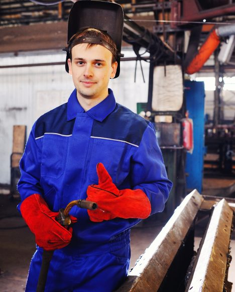 Male caucasian welder with thumbs up