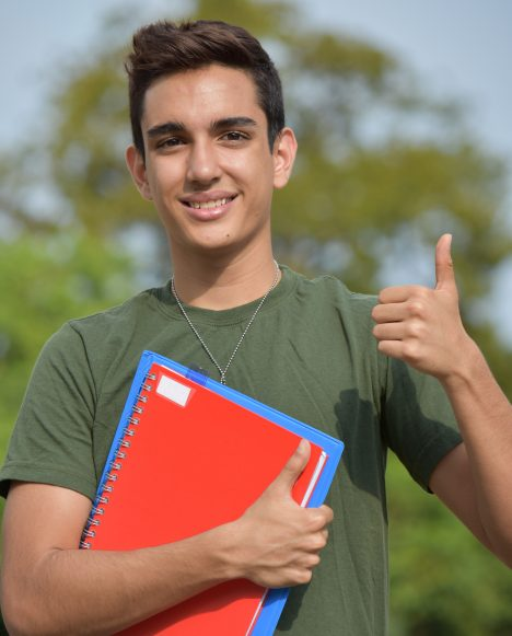 Hispanic male student with dogtags
