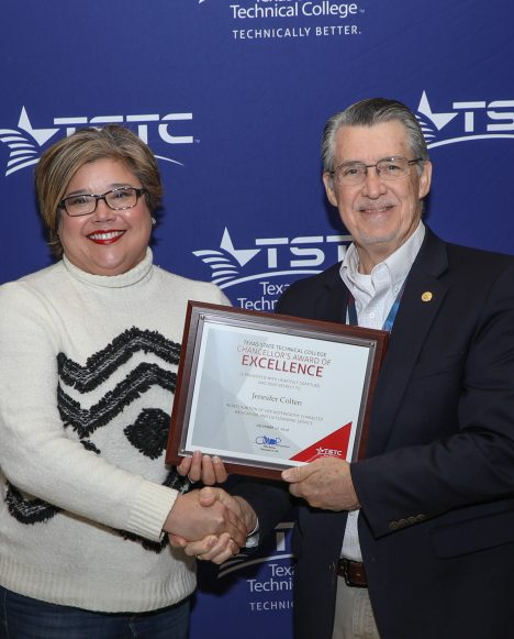 Hispanic female employee with the chancellor