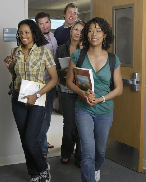 CAMP - Group of multiethic students walking out of classroom